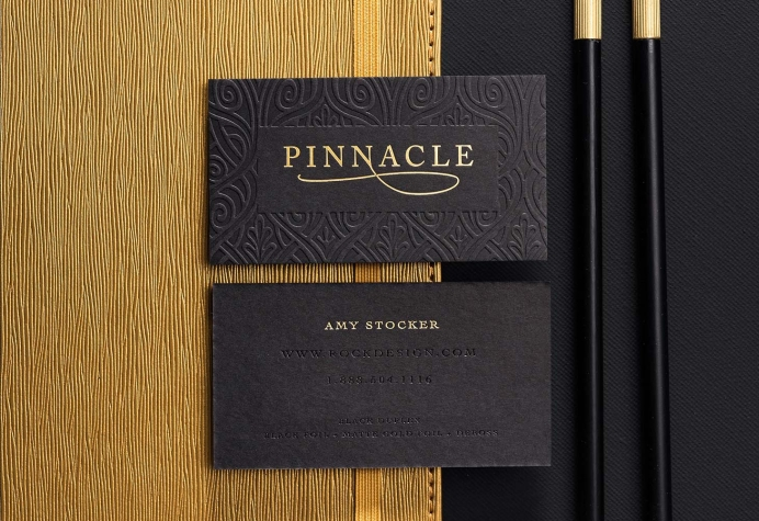 Black business cards with Gold foil and debossing