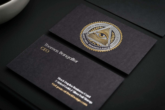 Black business cards with gold and silver stamping